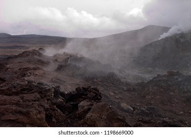 Steaming lava fields with sulfur smoke rising from the ground in Kafla, Iceland