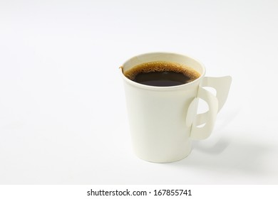 Steaming  paper coffee cup  on white background