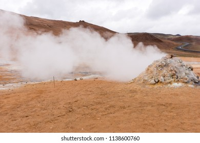 Steaming sulphur fumaroles at geothermal area Hverir in north Iceland