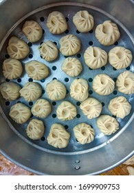 Steaming Traditional dumpling momos food from Nepal, delicious nepali / chinese food