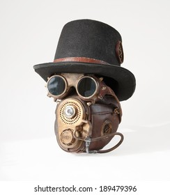 Steampunk accessories. Steampunk hat, goggles and mask isolated on the white background. These are partsof my steampunk costume.