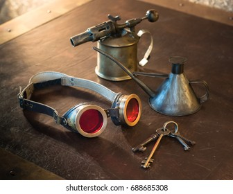 Steampunk accessories on a leather table