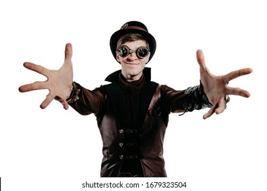 Steampunk actor in glasses and hat posing