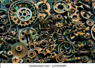 Steampunk background, machine parts, large gears and chains from machines and tractors. Old rusty machine and mechanical parts. Springs, bearings, pistons, crankshafts, camshafts.