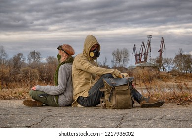 Steampunk or cyberpunk style adventurers couple, woman in goggles and neckerchief half face mask, man in hood and respirator gas mask, rest on the ground leaning back against each other