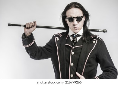 Steampunk gentelmen costume drama character shot in studio on white background.