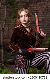 steampunk girl with weapons in an abandoned location