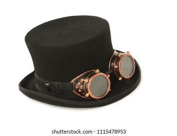 Steampunk hat and goggles on a white background. Studio photo with space for text.