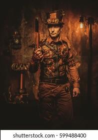 Steampunk man with gun on vintage steampunk background.