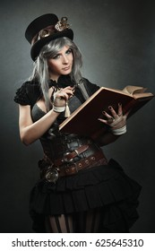 Steampunk scientist with open book and magnifying lens