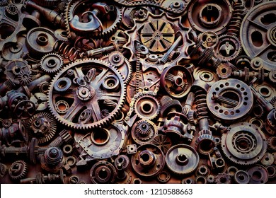 Steampunk texture, background with mechanical parts, gear wheels, steam punk cogwheels, heap of auto parts, old rusty iron chains, springs, wheels, close up