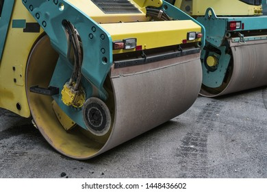 Steamroller. Asphalt. Road construction machinery.