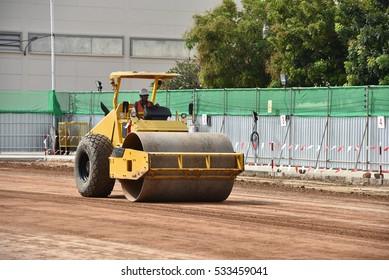 Steamroller compactor soil for adjust level on construction site