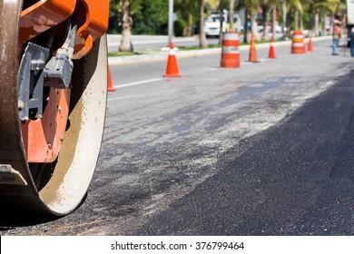 Steamroller during road construction. Asphalt pavement works