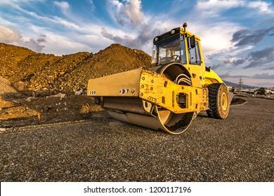 Steamroller performing road paving works