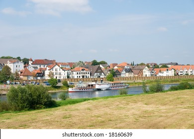 Steamship on the Weser River with Fachwerkhaus background in Minden, Germany