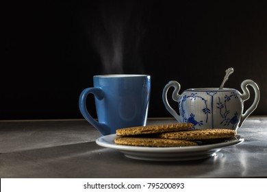 A steamy cup of coffee with some delicious syrup waffles.