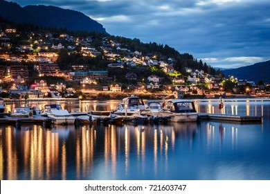 Stedje city in Norway at night with fjords