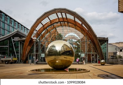 Steel ball in front of the Winter Gardens at St Paul's Place, Sheffield, Yorkshire, UK taken on 18 May 2018