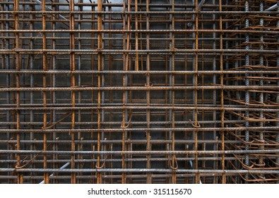 Steel bars reinforcement on construction site, vertical wall, editable background. Formwork used for concrete layering.