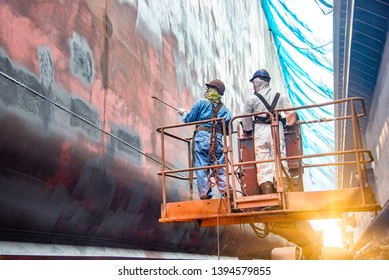 Steel basket carry by cherry picker crane for gang of worker power man, painting man or brush man working in high position, working at risk in dust under mesh sheet protection