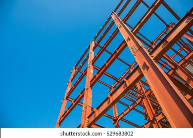 Steel beam construction pointing to the blue sky