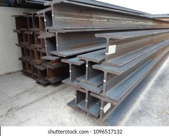 Steel beam lay on concrete floor in stack