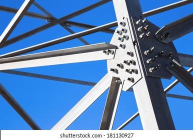 Steel beams against the blue sky. Metal framework.