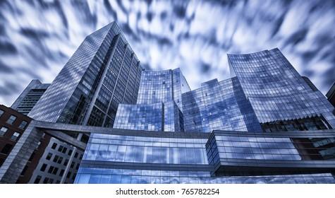 Steel blue glass skyscrapers long exposure shot