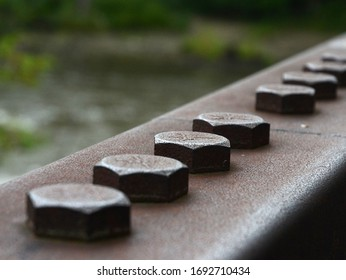 Steel bolts secure a hanrail on a walking bridge over Otter Vreek in Middlbury, Vermont.