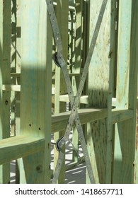 Steel braces on a timber frame house under construction