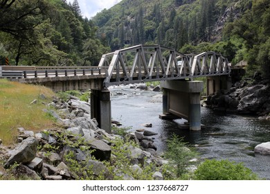 steel bridge over a river in a canyon