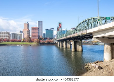 steel bridge over water with cityscape and skyline in portland
