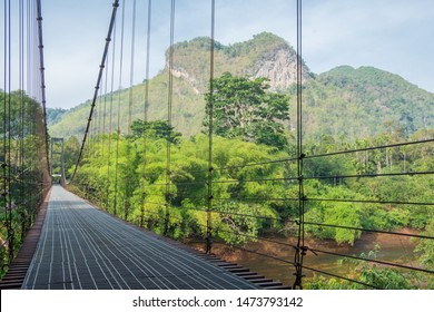 Steel bridge for people. railway bridge ,iron construction. Beautiful bridge in forest, with steel suspension bridge at foggy day in the morning.