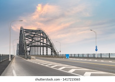 steel bridge and road with sunset sky, jiujiang city ,China