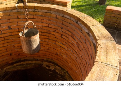 Superior The Steel Bucket Of Water On The Brick Water Well