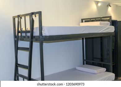 steel Bunk bed with a mattress covered by a white cloth, Stairs for bunk beds