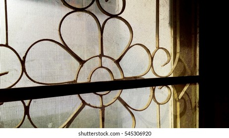 Steel cage curve bend stripes retro style on window, Concept good morning memory of some life in old building house and shop of Bangkok Thailand.