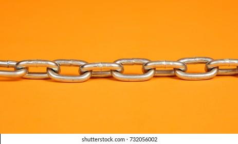 Steel chain on an orange background
