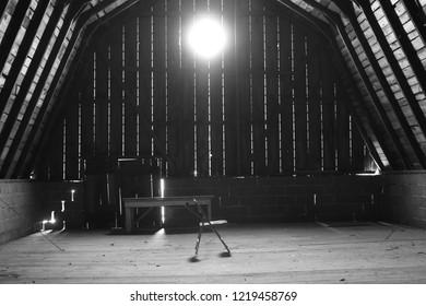 A steel chair, Inside a barn.