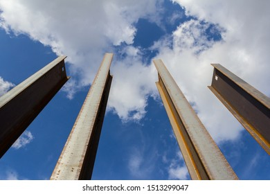 Steel channel on a background of blue sky. The use of steel channel to strengthen the foundation of the house in a construction site.