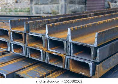 Steel channel on a construction site. The use of steel channel to strengthen the foundation of the house in a construction site.