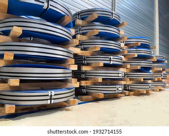 steel coil stacked one on top of the other, raw material, cold stamping, metal working in automotive industry, horizontal