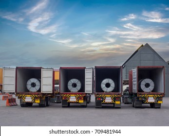 Steel coils in containers awaiting for unstuffing on turck at outdoor yard.