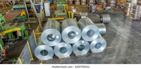 Steel coils in a warehouse, aerial view.