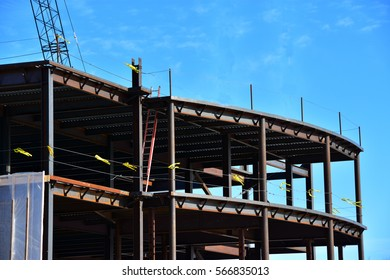 Steel and concrete multi-story commercial building under construction.