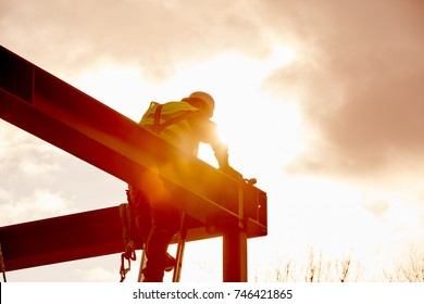 Steel construction with worker in back light