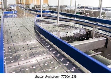 Steel conveyor for transportation of glass bottles. Belt and roller conveyors.