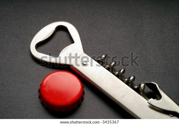 Steel corkscrew and bottle opener with red crown cap (2)