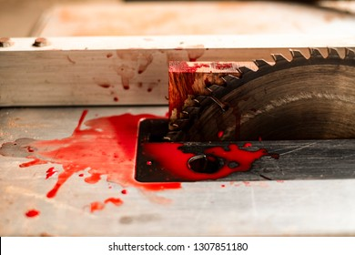 Steel cutting circular saw disc bloody on blurred background, Safety first, Dangers of using power tools